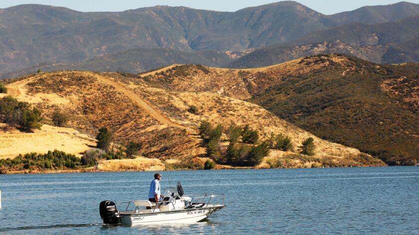 Wick Wright pilots his fishing boat at Castaic Lake.