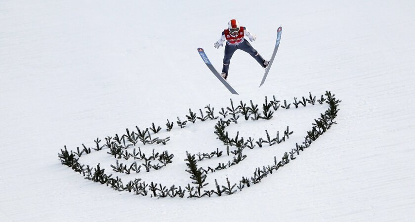 Austria's Thomas Diethart soars during his final jump to win at the second stage of the four hills ski jumping tournament in Garmisch Partenkirchen, southern Germany, Wednesday, Jan. 1, 2014. (AP Photo/Matthias Schrader)
