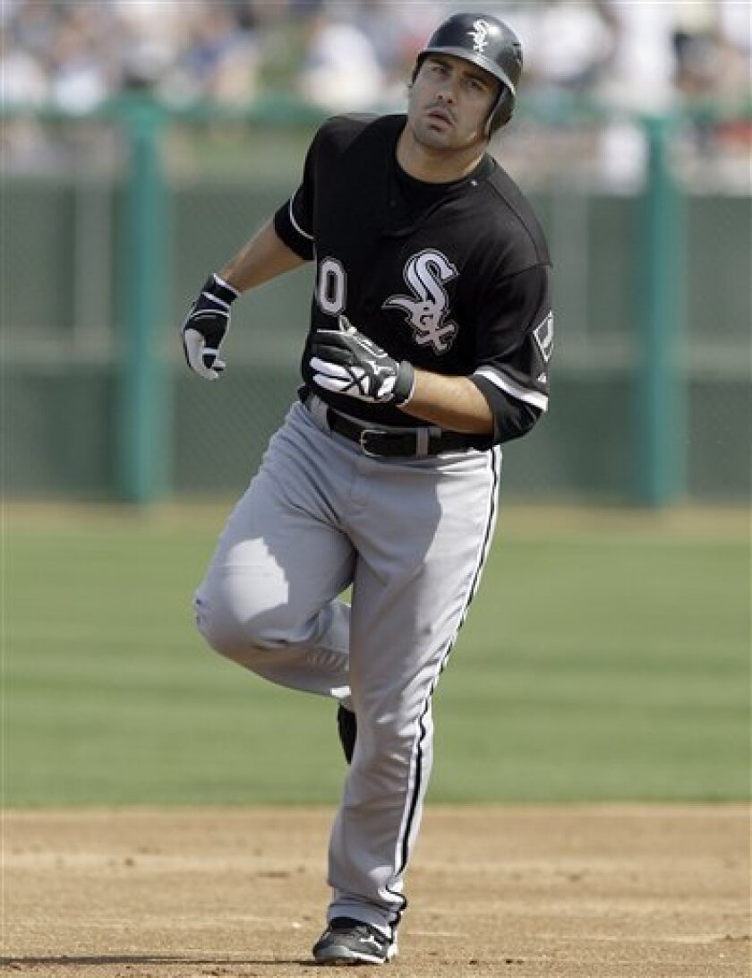 Chicago White Sox Carlos Quentin rounds the bases after hitting a two-run home run off Chicago Cubs pitcher Carlos Silva in the first inning of an spring training baseball game Saturday, March 6, 2010, in Mesa, Ariz. (AP Photo/Paul Connors)
