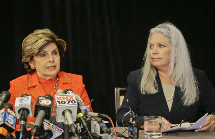 Attorney Gloria Allred, left, with her client, Irene McCormack Jackson, former communications director for San Diego Mayor Bob Filner, at a news conference where they revealed details regarding their accusations of sexual misconduct against the mayor.