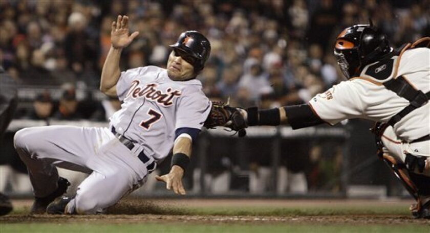 Detroit Tigers' Ivan Rodriguez, left, was ruled safe on this play at home as San Francisco Giants catcher Bengie Molina makes the tag during the seventh inning of a baseball game Monday, June 16, 2008, in San Francisco. This play caused the subsequent ejection of Giants manager Bruce Bochy. (AP Photo/Ben Margot)