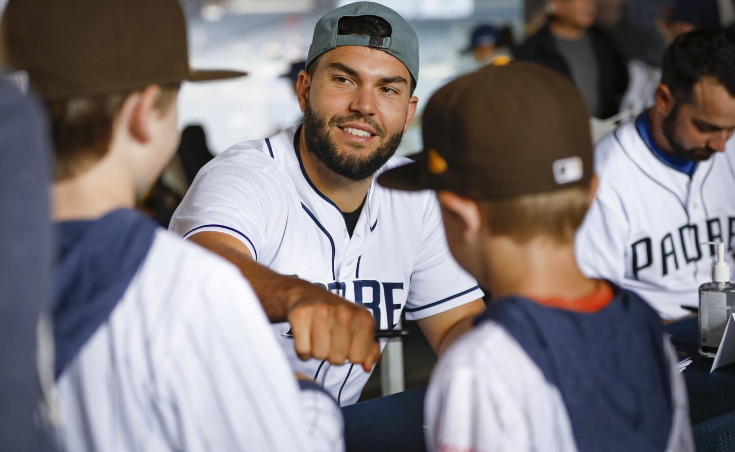 SAN DIEGO, CA 1/12/2019: Padres first baseman Eric Hosmer, fist bumps a couple of young fans during FanFest 2019, at Petco Park. Photo by Howard Lipin/San Diego Union-Tribune/Mandatory Credit: HOWARD LIPIN SAN DIEGO UNION-TRIBUNE/ZUMA PRESS