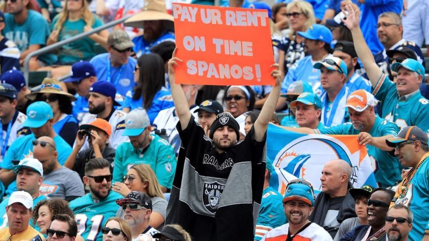 A fan holds a sign during the game between the Chargers and the Miami Dolphins at the StubHub Center