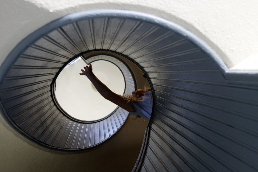 At the lighthouse at Cabrillo Monument, Kaitlyn Rogers of Vista reaches out to touch the walls of the Spiral staircase.  The public was allowed to enter the lighthouse as part of National Park Founders Day.