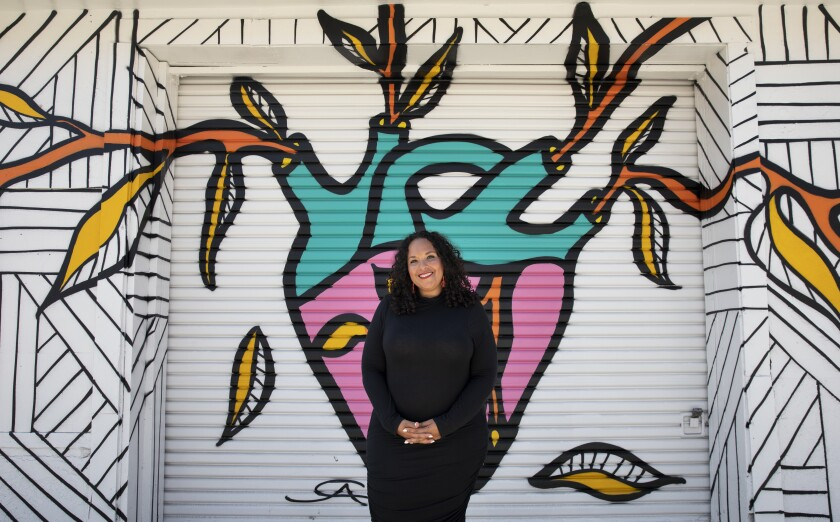 Afira DeVries poses outside of The Chrysalis: Monarch Center for the Arts in Barrio Logan