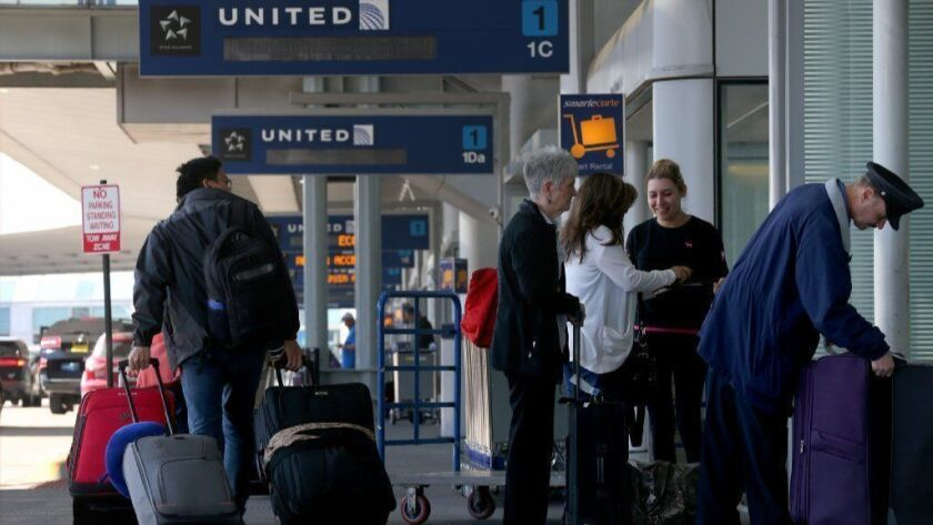 The United Airlines terminal at Chicago O'Hare International Airport is seen April 12, 2017. The airline is making it harder to reach the top level of its frequent flyer program.