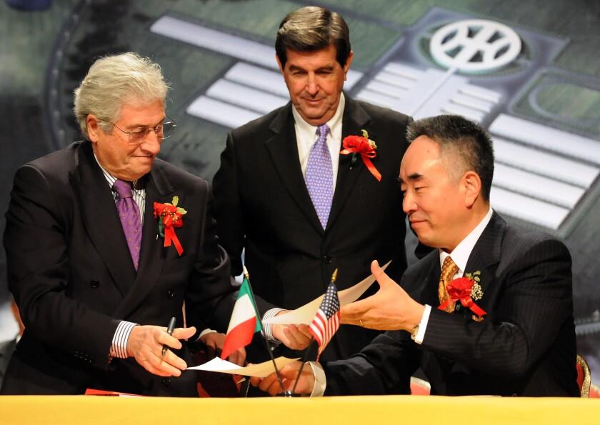 Italdesign Giugiaro Chairman Giorgetto Giugiaro, left, and Hybrid Kinetic Motors Corp. Chairman Yung Yeung
