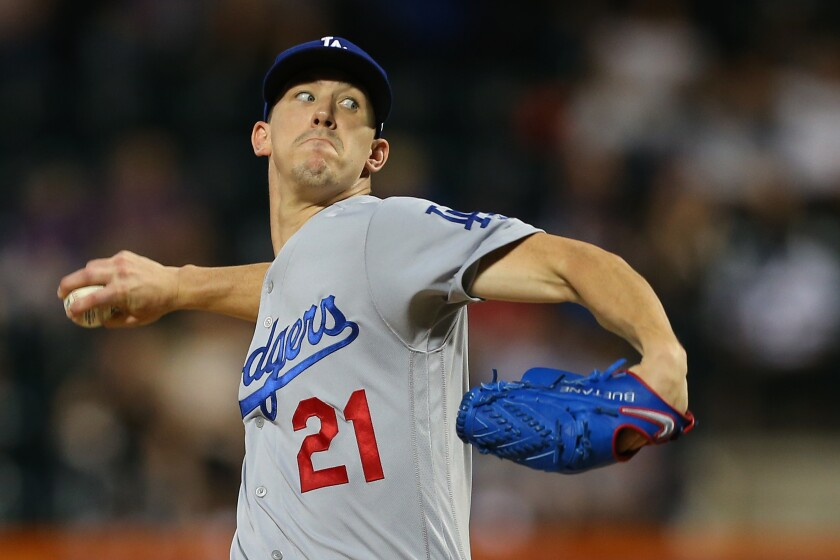 Dodgers starter Walker Buehler delivers against the New York Mets on Sunday.