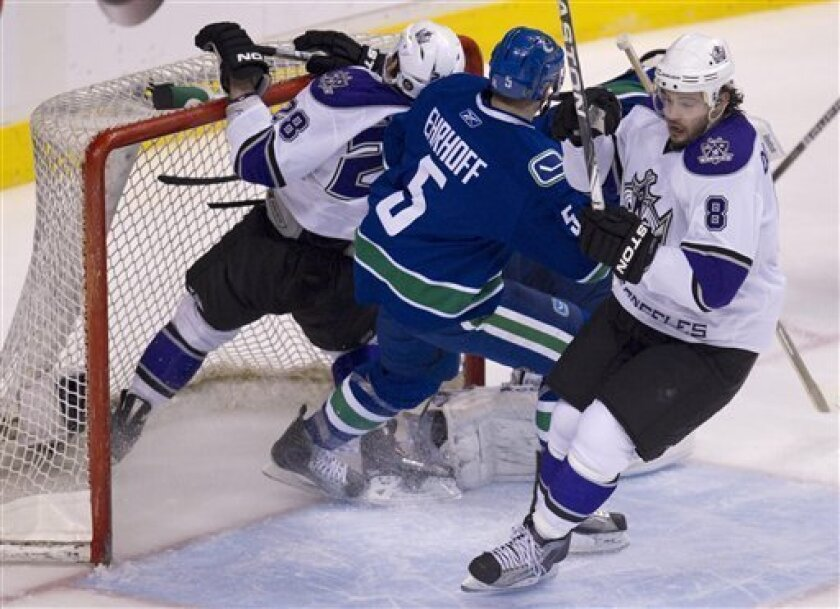 Los Angeles Kings center Jarret Stoll (28) crashes into the Canucks nets as Vancouver Canucks defenseman Christian Ehrhoff (5) and Los Angeles Kings defenseman Drew Doughty (8) look on during second period NHL hockey action at Rogers arena in Vancouver, British Columbia, Thursday, March 31, 2011.