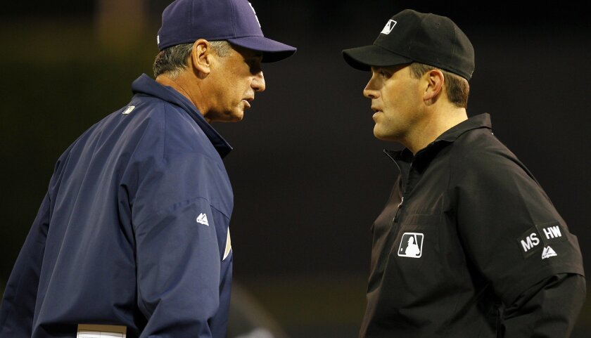 Padres' manager Bud Black argues with umpire Brian Knight after he called Cameron Maybin out at first base after a hit in the 8th inning against the Reds on Thursday, July 5, 2012.