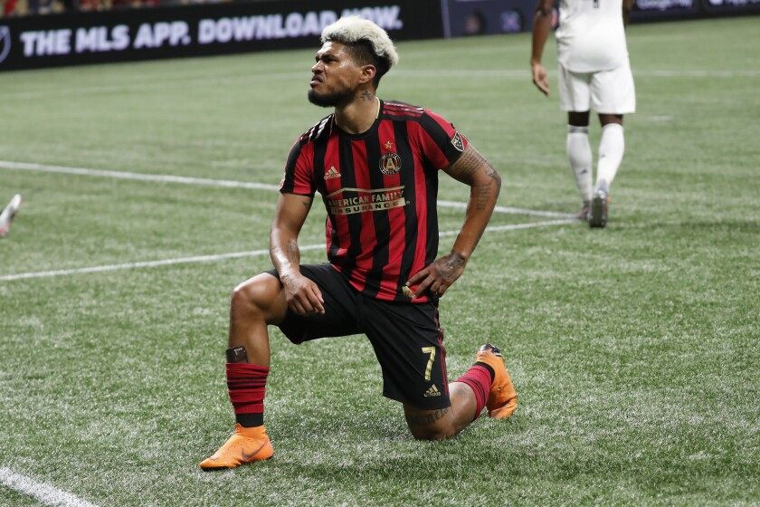 FILE - In this Oct. 24, 2019 file photo Atlanta United forward Josef Martinez (7) strikes a pose after scoring a goal in second half of an MLS Eastern Conference Semifinal playoff soccer match against the Philadelphia Union in Atlanta. Martinez will undergo surgery after tearing the ACL in his right knee during the season-opening match at expansion Nashville, dealing a huge blow to one of Major League Soccer's top teams. United announced the diagnosis Sunday, March 1, 2020 for the league's 2018 MVP but did not disclose if the anterior cruciate ligament was completely torn. (AP Photo/John Bazemore, file)