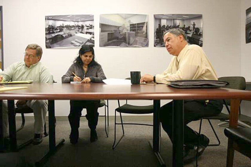 "Larry Eisenberg, head of the construction program, right, at a meeting. In an April 2009 e-mail, he told his construction chief that quality control was ""horrible,"" adding: ""We are opening buildings that do not work at the most fundamental level."""