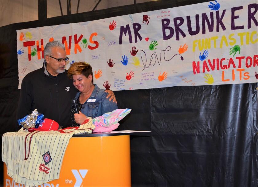 Michael Brunker with Thanks banner (2).jpeg