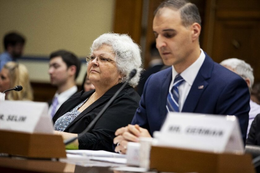 """Susan Bro, left, whose daughter Heather Heyer was killed while protesting the """"Unite the Right"""" rally in Charlottesville, Va., and George Selim, senior vice president of programs at the Anti-Defamation League, listen during a House Civil Rights and Civil Liberties Subcommittee hearing on confronting white supremacy at the U.S. Capitol on Wednesday in Washington, D.C."""