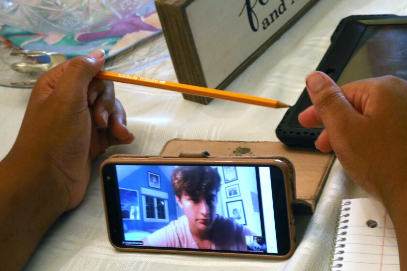 Malachi Morris-Jackson is tutored for free via smartphone by Cooper Silverman.