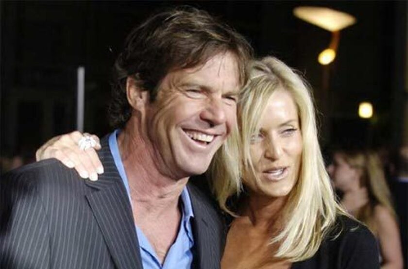 Dennis Quaid and wife Kimberly arrive at a film premiere in 2006. The couple's newborn twins were given an accidental overdose of the blood thinner heparin.