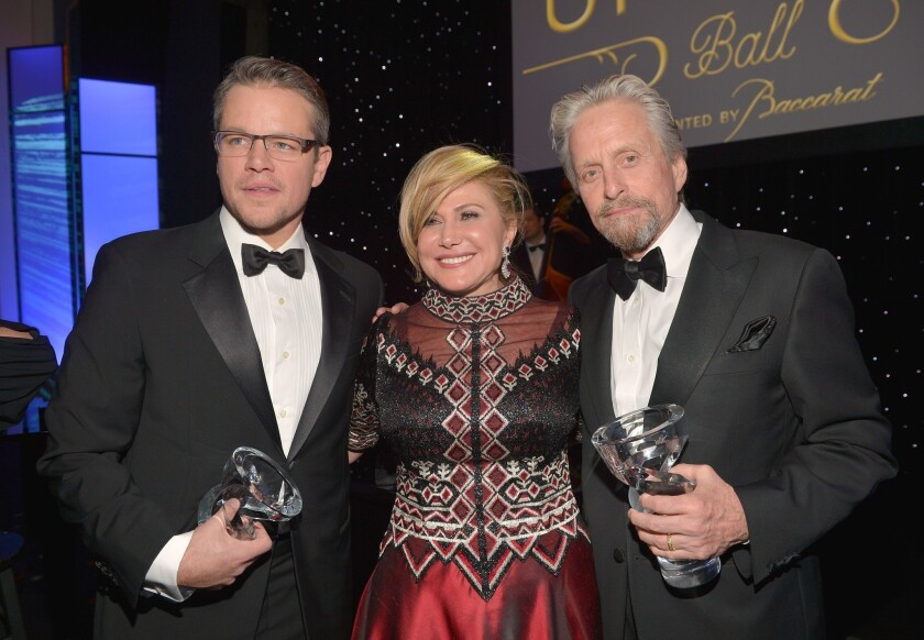 Matt Damon, left, Ghada Irani and Michael Douglas appear at the 2014 UNICEF Ball at the Beverly Wilshire Four Seasons Hotel.