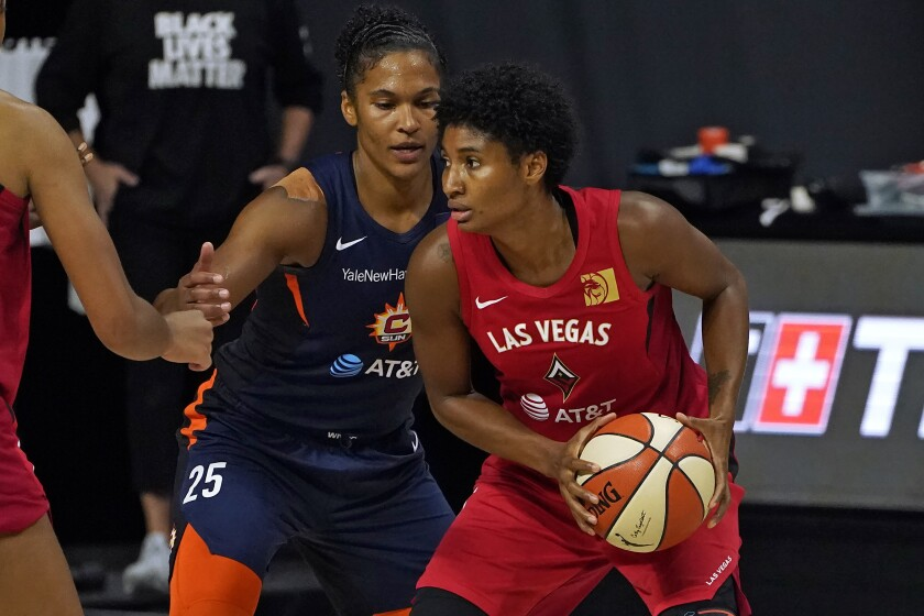 Las Vegas Aces forward Angel McCoughtry looks around Connecticut Sun center Brionna Jones.