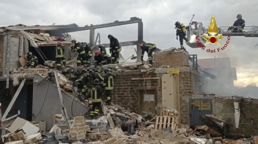 Firefighters inspect the remains of a laboratory that was destroyed by a fire in Gubbio, central Italy, Friday, May 7, 2021. A blaze on Friday at a small laboratory in central Italy that treats marijuana so it can be used medically left a man dead, three people injured and one person missing, Italian firefighters said. Flames raged through a small building in the countryside outside of Gubbio, a town in the Umbria region. (Vigili del Fuoco via AP)