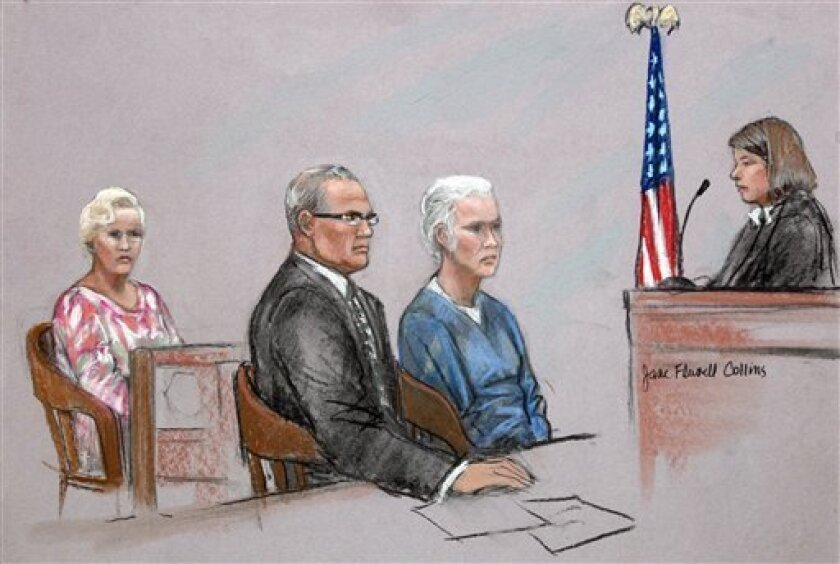 """This courtroom sketch depicts Catherine Greig, second from right, longtime girlfriend of former crime boss James """"Whitey"""" Bulger, during a hearing before Magistrate Judge Jennifer Boal, right, in a federal courtroom in Boston Monday, July 11, 2011. Her attorney, Kevin Reddington, second from left, and her sister Margaret McCusker, left, also are depicted. Greig is charged with harboring a fugitive. Her hearing was recessed until Wednesday. (AP Photo/Jane Flavell Collins)"""