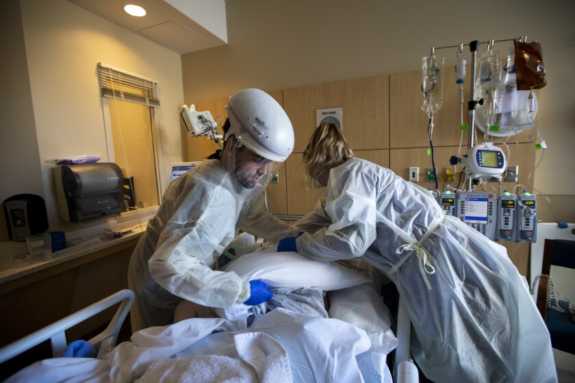 Nurses reposition a patient at Providence Holy Cross Medical Center in Mission Hills.