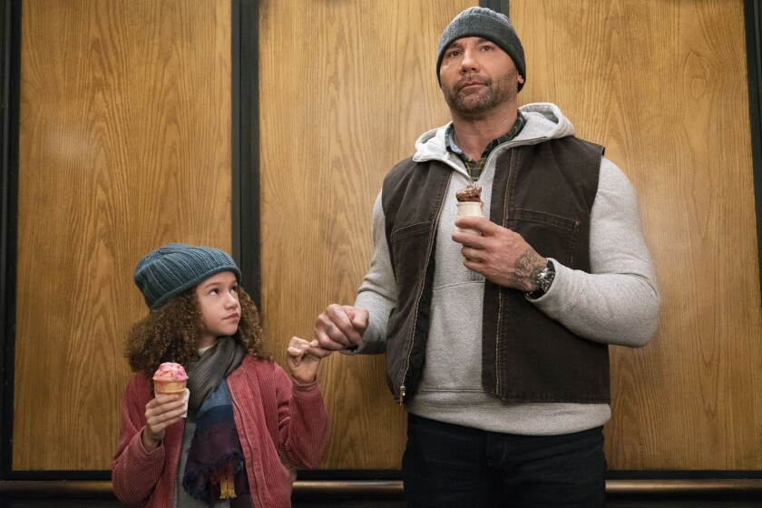 "Sophie (Chloe Coleman) and mayhem specialist JJ (Dave Bautista) enjoy some ice cream in the comedy ""My Spy."""