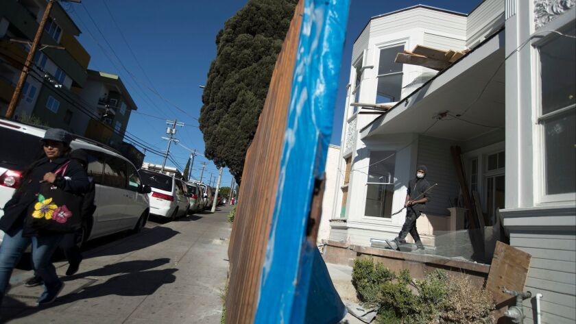 LOS ANGELES, CALIF. -- FRIDAY, FEBRUARY 23, 2018: A Victorian duplex is being renovated on Burlingt