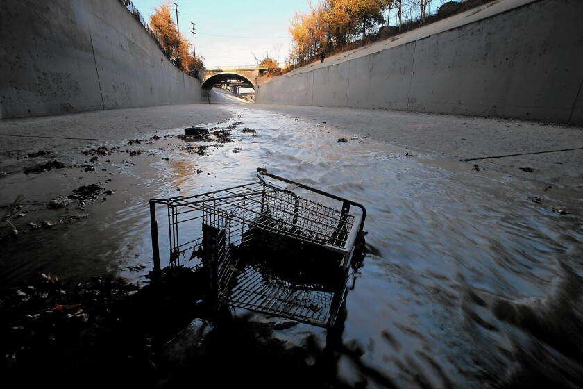 A grocery cart lies in the stream of the Arroyo Seco at its confluence with the L.A. River.