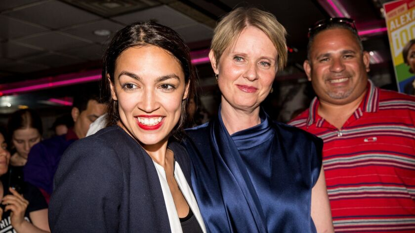 Progressive challenger Alexandria Ocasio-Cortez celebrates with New York gubenatorial candidate Cynthia Nixon at her victory party in the Bronx after upsetting incumbent Democratic Rep. Joseph Crowley on Tuesday.
