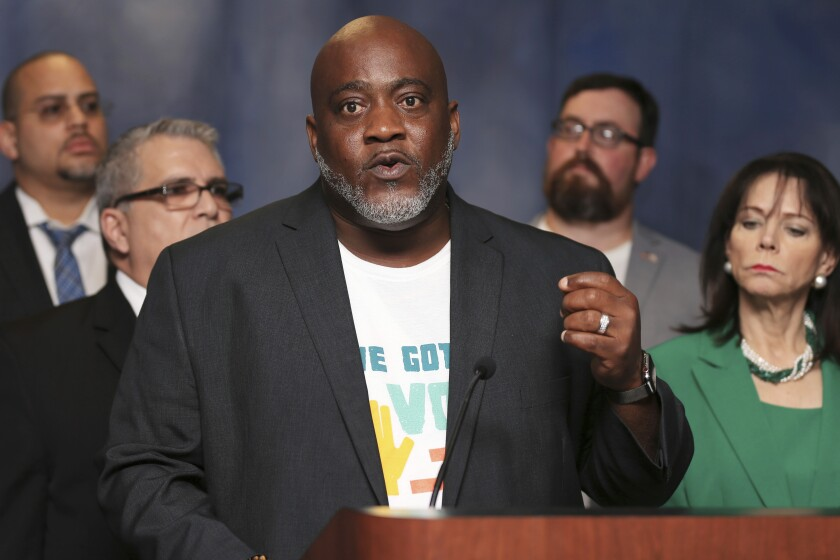 FILE - In this July 29, 2019, file photo, Desmond Meade, president of the Florida Rights Restoration Coalition, talks about Amendment 4 during a news conference at the Miami-Dade County State Attorney's Office in Miami. Meade, the Florida activist who led a movement to allow most former felons to vote, got more civil rights restored under a new state clemency program, Meade announced in a Twitter video posted Saturday, Oct. 9, 2021. (Sam Navarro/Miami Herald via AP, File)