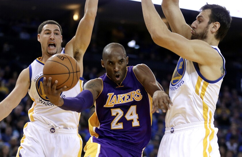 Kobe Bryant, shown driving between Golden State's Klay Thompson and Andrew Bogut, scored 28 points in the Nov. 1 game, but the Lakers still lost, 127-104, in Oakland.