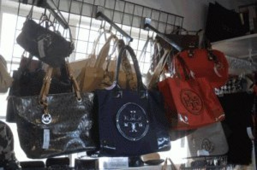Designer handbags and purses are the bestsellers at most La Jolla consignment shops.