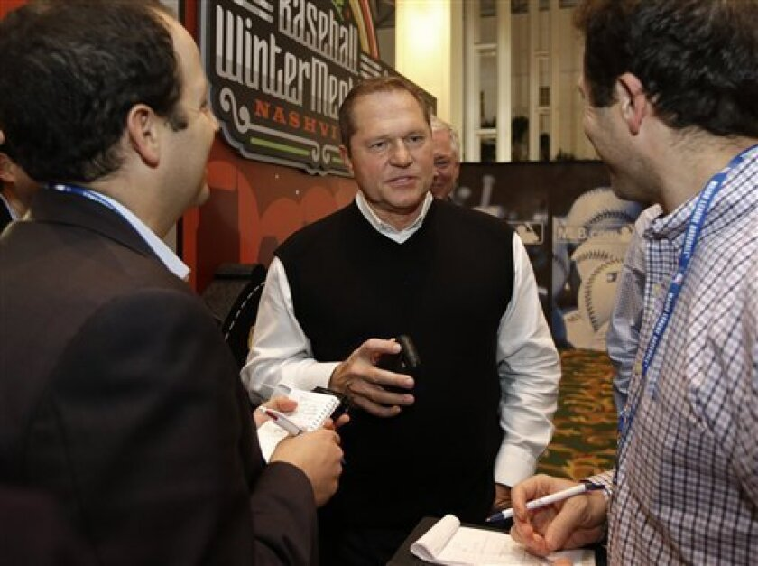 Sports agent Scott Boras, center, talks with reporters at the baseball winter meetings on Wednesday, Dec. 5, 2012, in Nashville, Tenn. (AP Photo/Mark Humphrey)