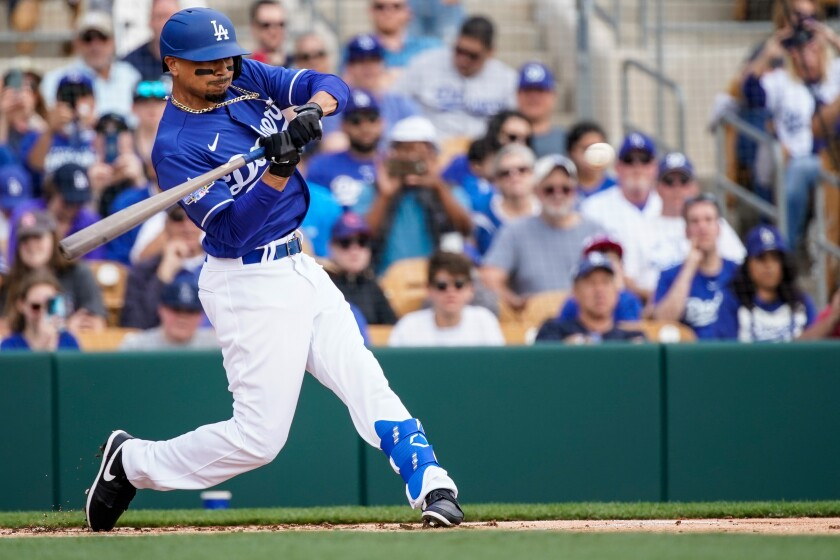 Mookie Betts swings at a pitch during his first exhibition at bat for the Dodgers against the Chicago Cubs at Camelback Ranch on Sunday.