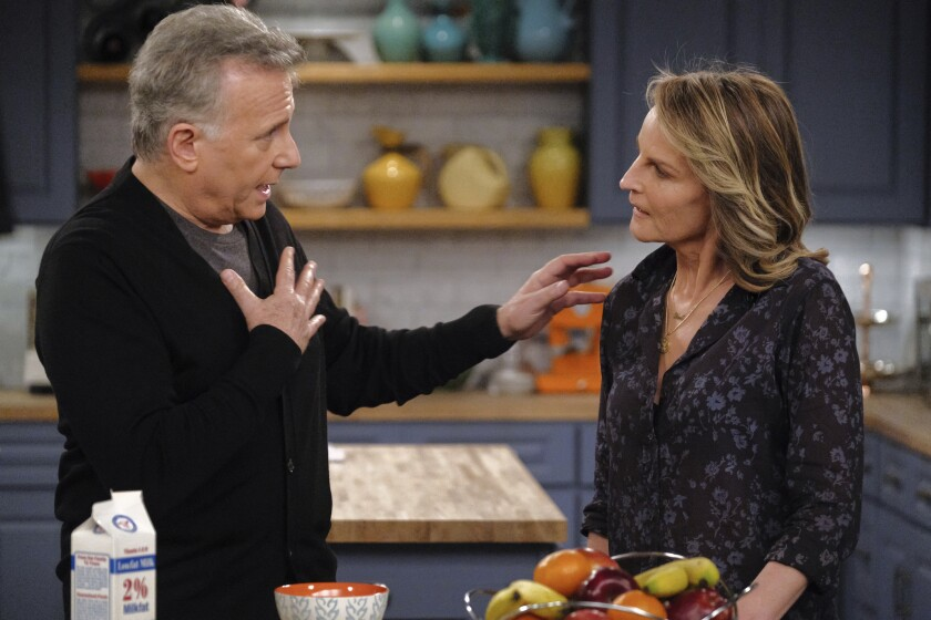 "This image released by Sony Pictures Television/Spectrum Originals shows Paul Reiser, left, and Helen Hunt in a scene from ""Mad About You,"" a reboot of the 1990s comedy series. The limited series debuts Wednesday on Spectrum Originals for on-demand subscribers. (Darren Michaels/Sony Pictures Television/Spectrum Originals via AP)"