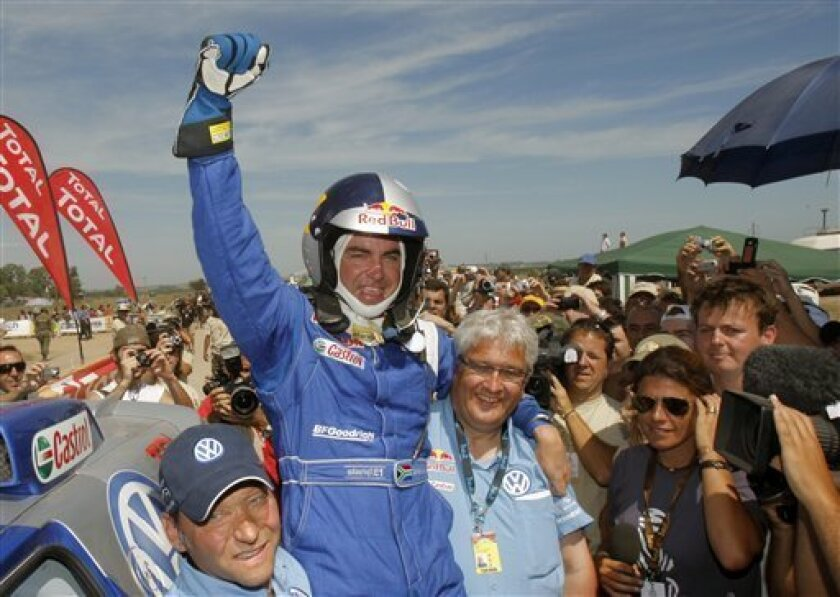 Volkswagen driver Giniel De Villiers of South Africa celebrates after winning the Argentina-Chile Dakar Rally 2009 in Carcarana, Argentina, Saturday, Jan. 17, 2009. (AP Photo/Christophe Ena)