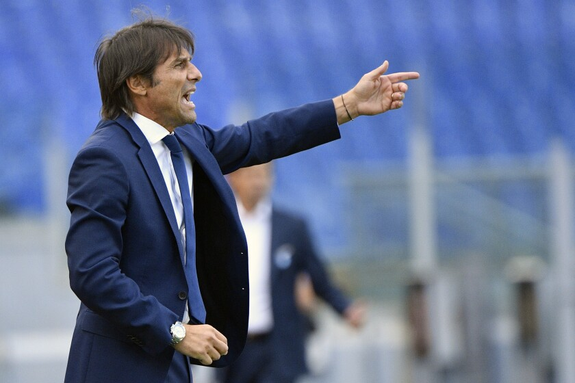 Inter coach Antonio Conte gives instructions during the Serie A soccer match between Lazio and Inter Milan at the Rome Olympic Stadium Sunday, Oct. 4, 2020. (Fabrizio Corradetti/LaPresse via AP)