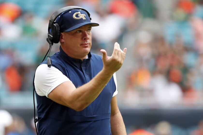 FILE - In this Oct. 19, 2019, file photo, Georgia Tech head coach Geoff Collins gestures during the first half of an NCAA college football game against Miami in Miami Gardens, Fla. With doubts still hanging over the season because of the coronavirus pandemic, Georgia Tech begins practice for Year 2 under coach Geoff Collins. (AP Photo/Wilfredo Lee, File)