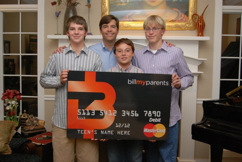 Michael McCoy, CEO of BillMyParents, at home in San Diego with his children, 15-year-old Mason, 12-year-old Miller and 17-year-old Mitchell.