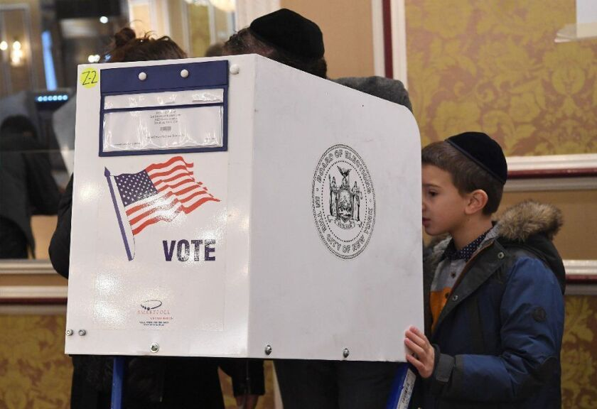 Brooklyn voters cast their ballots at the East Midwood Jewish Center polling station.