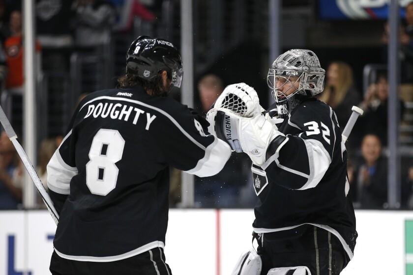 Kings goalie Jonathan Quick (32) and Drew Doughty (8) celebrate their team's 2-1 win against the Philadelphia Flyers on Jan. 2.