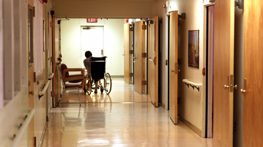 A patient makes his way down the hall of a ward for the mentally ill at Camarillo State Hospital.