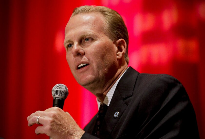 San Diego City Council member Kevin Faulconer answers a question during the first mayoral debate with fellow City Council member David Alvarez and former City Attorney Michael Aguirre. The debate was sponsored by the Asian Business Association of San Diego.