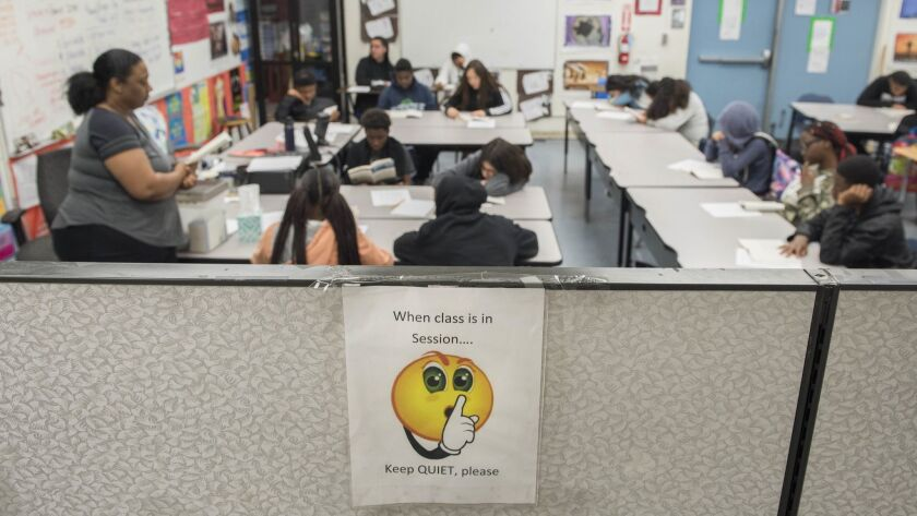 Students at Magnolia Science Academy 3 learn in a makeshift classroom created with dividers in the school's office space. Efforts to rent empty additional empty space on the campus of Curtiss Middle School in Carson have hit roadblocks.