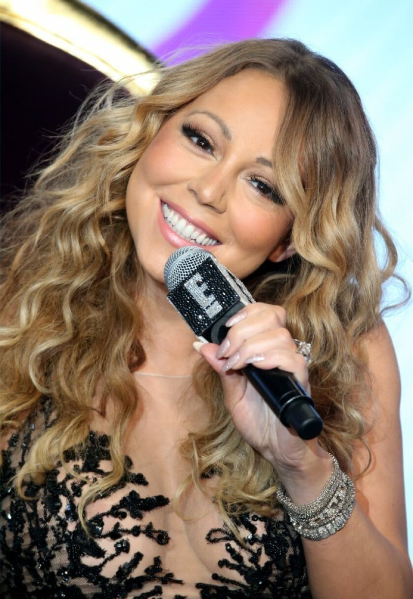 """Mariah Carey speaks onstage at the """"Mariah's World"""" panel discussion."""