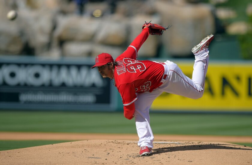Los Angeles Angels starting pitcher C.J. Wilson throws to the plate during the first inning of a baseball game against the Cleveland Indians, Wednesday, April 30, 2014, in Anaheim, Calif. (AP Photo)