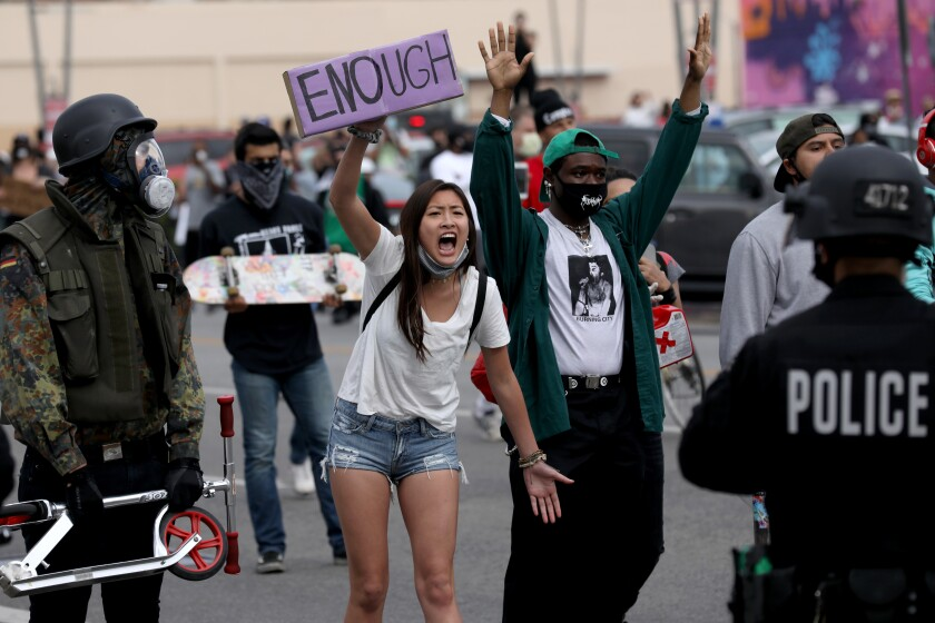 Protesters demonstrate in response to the death of George Floyd