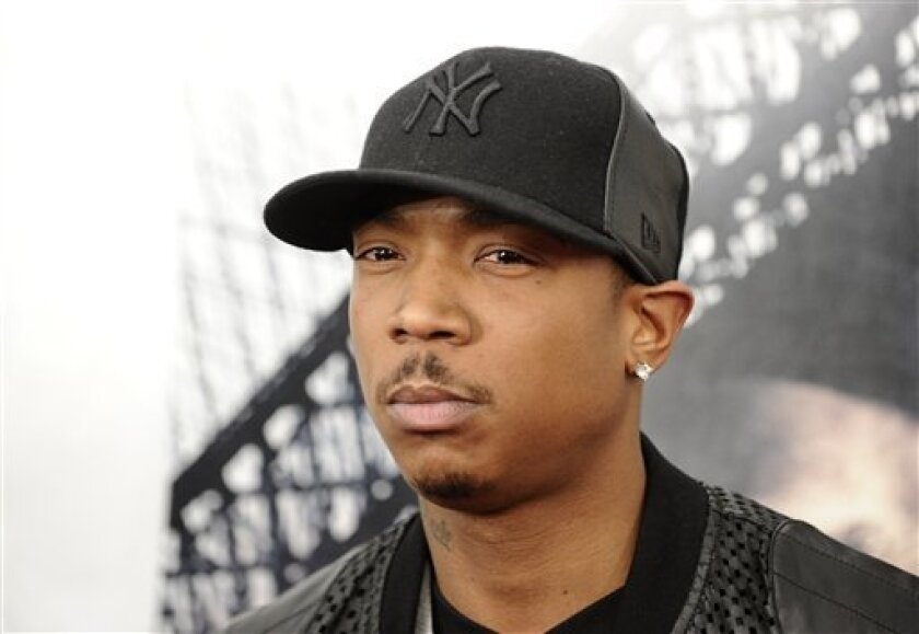 """FILE - In this March 2, 2010 file photo, rapper Ja Rule attends the premiere of """"Brooklyn's Finest"""" in New York. Platinum-selling rapper Ja Rule was set to leave an upstate New York prison on Thursday, Feb. 21, 2013 after serving most of his two-year sentence for illegal gun possession but head str"""