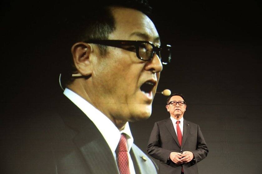 President Akio Toyoda delivers a speech during  a press conference on artificial intelligence in Tokyo, Friday, Nov. 6, 2015. Toyota is investing $1 billion in a research company it's setting up in Silicon Valley to develop artificial intelligence and robotics, underlining the Japanese automaker's