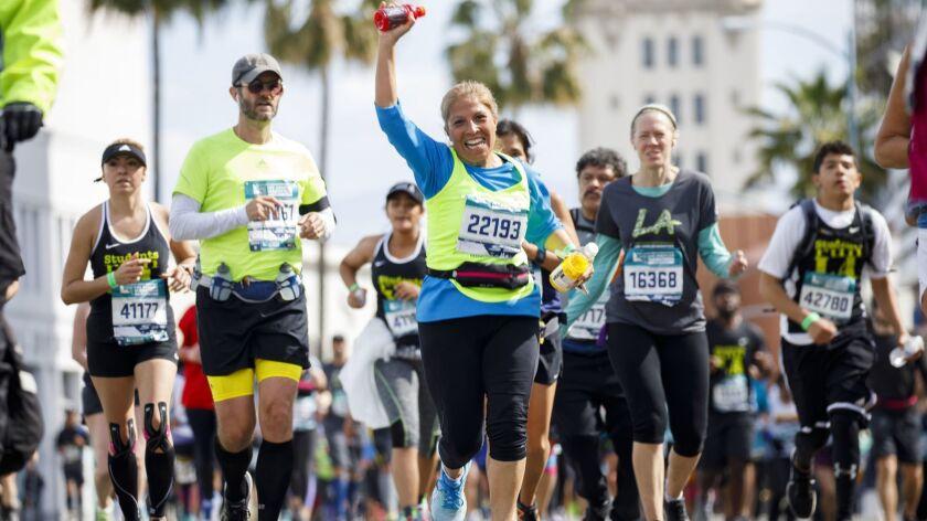 Runners in the L.A. Marathon make their way down Santa Monica Boulevard at the 17th mile.